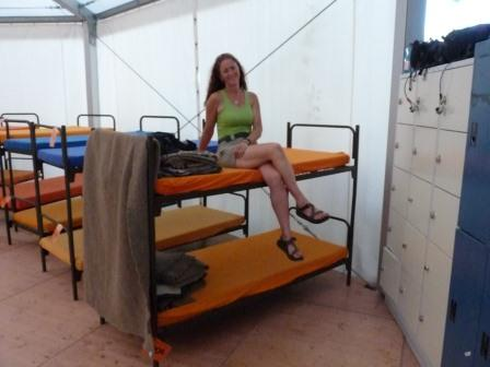 Diane on bunk at The Tent