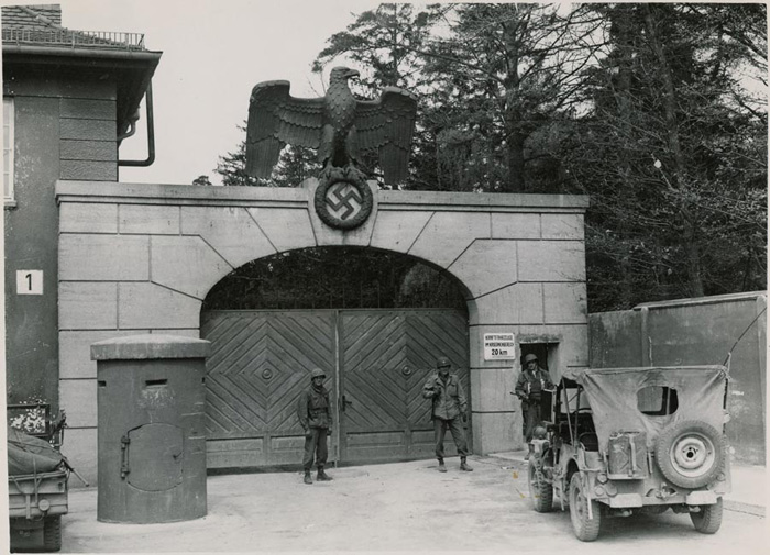 U.S. troops guarding Dachau entrance after liberation