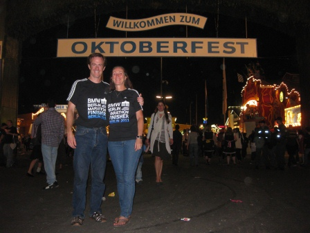 Patrick and Diane in front of Oktoberfest welcome sign