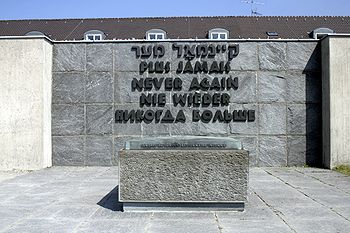 Monument at Dachau with the words Never Again in several languages