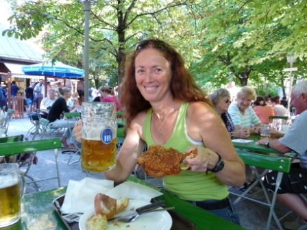 Diane enjoying beer and a pig's knuckle in a Munich beer garden