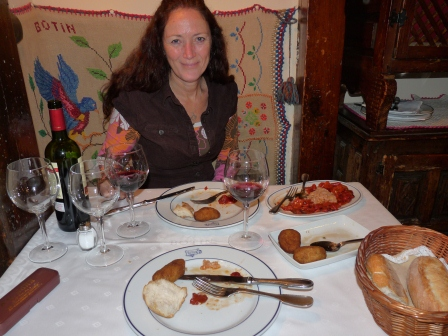 Diane with partially eaten appetizers at Sobrino de Botin