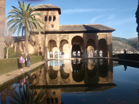 Alhambra architecture reflected in rectangular pool