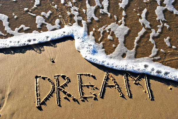 "The word ""Dream"" written in the sand with water"