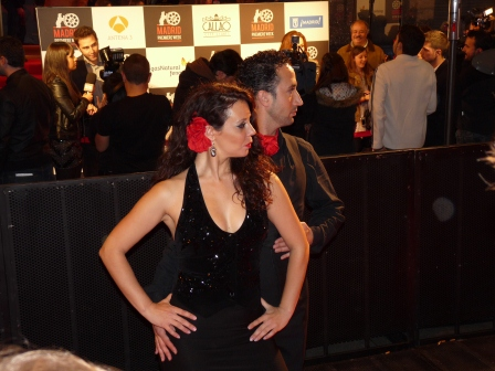 Male & female flamenco dancers poised to begin a number on the red carpet