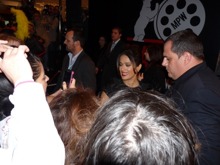 Salma Hayek walking the red carpet with her handlers