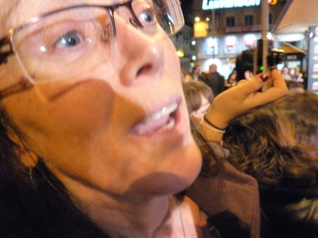 Close up of Diane in crowd looking at Antonio