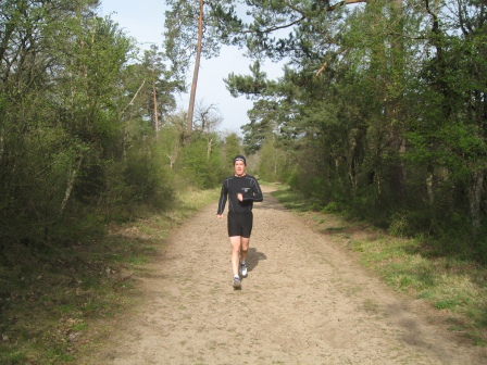 Patrick running on a wide train in the forest surrounding Fontainebleau