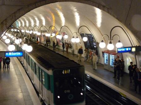 Métro train arriving at an underground station in Paris