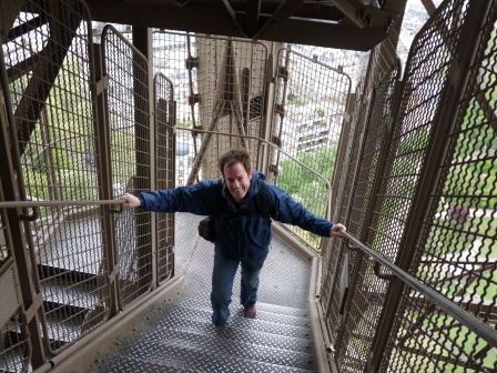 Patrick climbing the steps of the Eiffel Tower