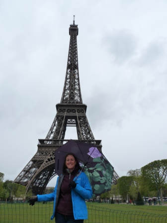 Diane with umbrella in front of the Eiffel Tower