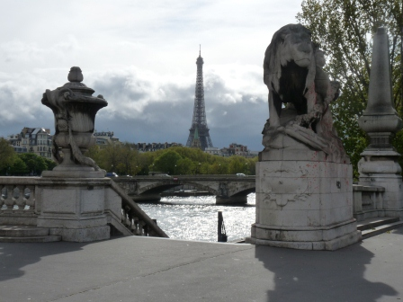 A staircase leading to the Seine with the Eiffel Tower in the background