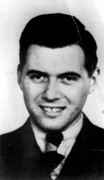 Black and white head shot of Joseph Mengele in a suit and tie