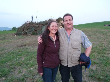 Andreas with his arm around Diane in front of the witch pyre