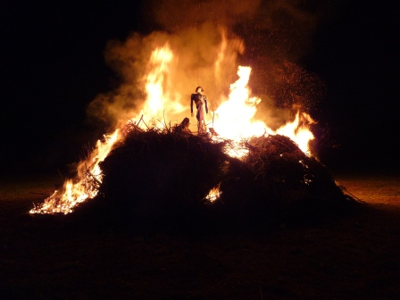 The burning pyre with the remnants of a witch on top