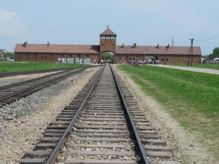 Low angle image of train tracks leading up to Birkenau Gate