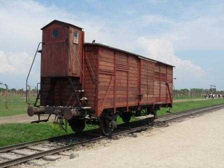 Single wooden rail car sitting on tracks