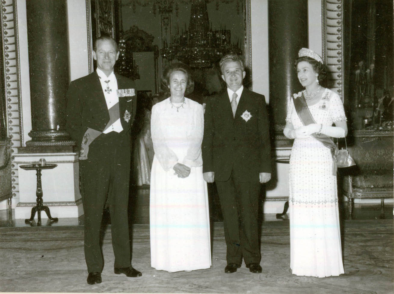 Ceauşescu with wife and Queen Elizabeth with Prince Phillip standing in a line for formal black and white photo