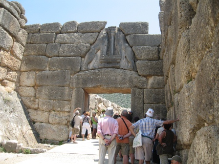 Photo of Lion Gate at Mycenae with tourists in the foreground