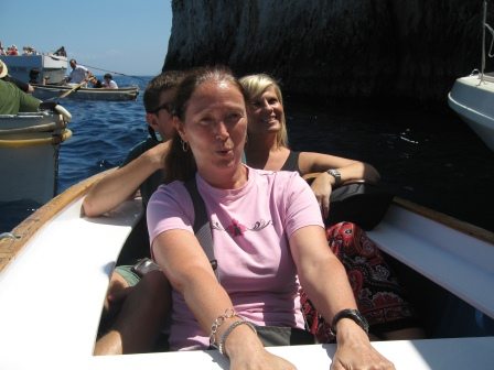 Diane holding on and looking worried in the stern of the row boat