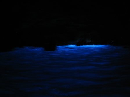 A blue glow in a black space