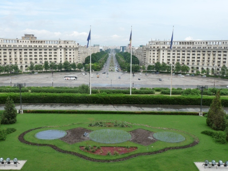 Looking over garden, flags, plazza, and long boulevard stretching into the distance