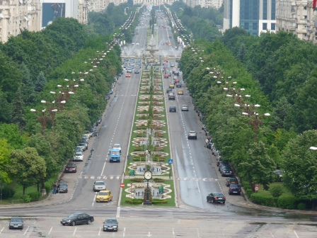 Long boulevard with fountains and lined with trees, stretching into the distance