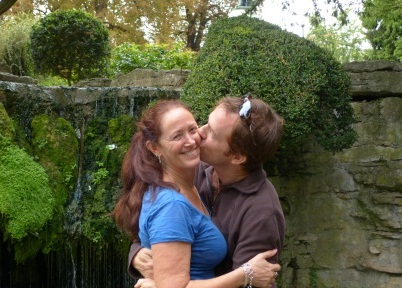 Patrick kissing Diane in front of a fountain in Dole, France