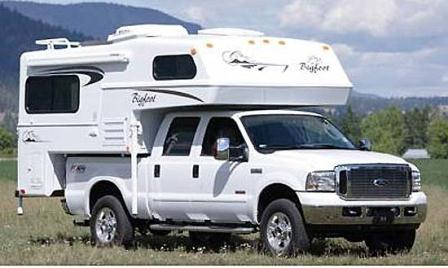 A gerneric white camper on a white truck