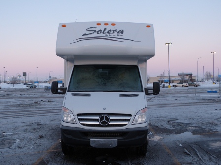 RV Front at sunrise in frosty, icy parking lot