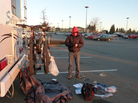 Patrick working on project at rear of motorhome in Walmart parking lot