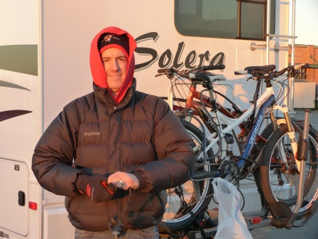 Patrick standing in front of bikes on rear of motorhome