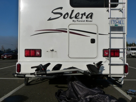 The rear of motorhome with 2 new tail lights, the license plate and its light relocated to the ladder