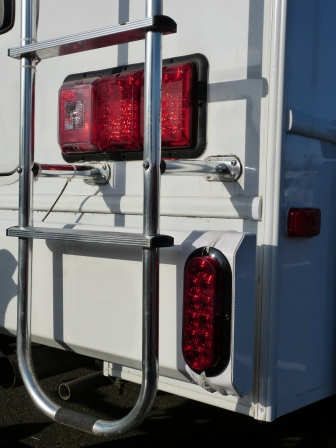 Close up of new tail light on rear bubmper on right rear corner of motorhome