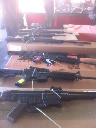 Assult rifles lying on a table