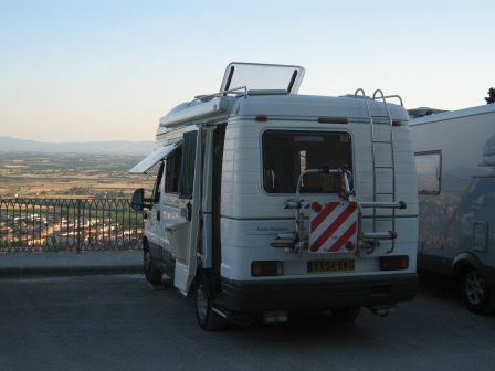 Our RV in a parking lot overlooking the Tuscan countryside