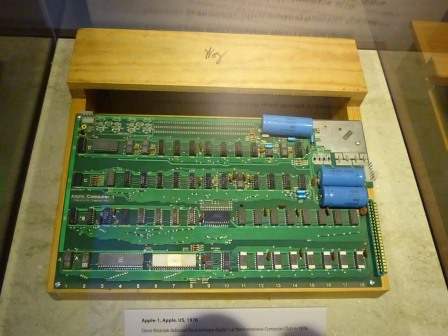 A greet circuit board in a open-topped wooden case
