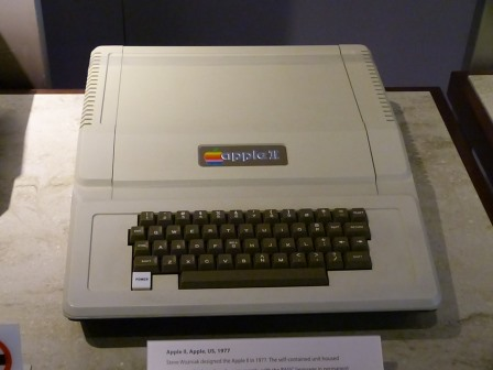 A beige Apple II computer with keyboard, flat top, and Apple logo