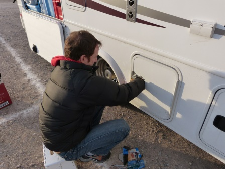 Patrick working on compartment latch with duct tape