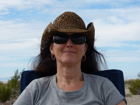 Dinae wearing a cowboy hat and sun glasses