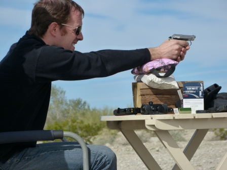 Patrick shooting a tiny black handgun