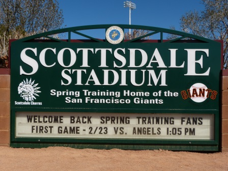 Green Scottsdale stadium sign showing names of teams play