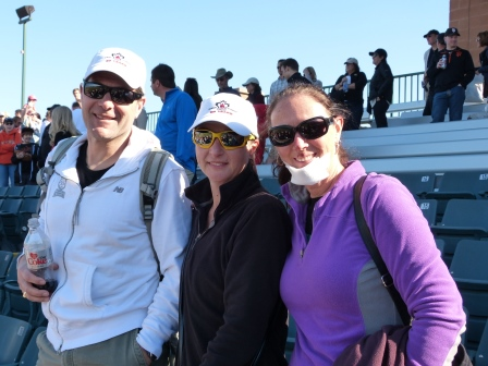 Kevin, Anette, and Diane with new chin bandage standing in the stadium bleachers