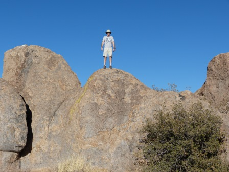 Patrick standing on high rock