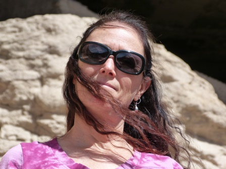 Diane with rocks behind her and her hair blowing across her chin