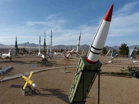 Many missiles including one pointing upward on an angle in the foregorund