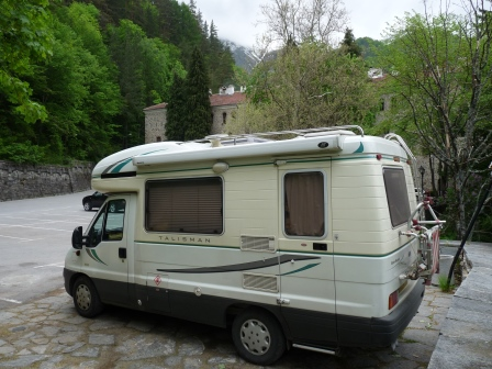 OUr motorhome parked by the river in front of Rila Monastery