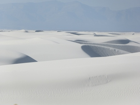 White sand dunes extending into the distance