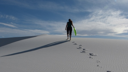 Diane walking away across the white sand