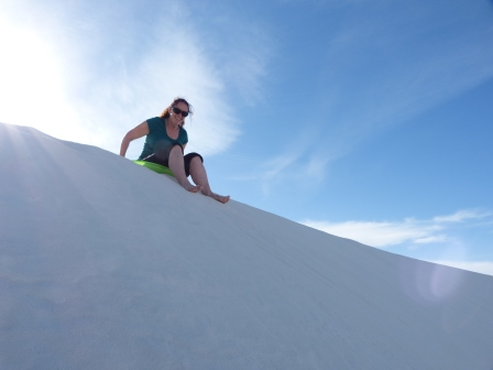 Diane sitting at the top of a dune